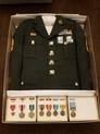 Military uniform in safe storage box and preserved